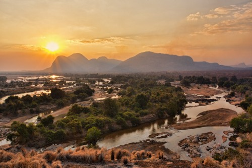 The Lugenda River in Niassa wanders across a plain studded with inselbergs, or granite mountains.